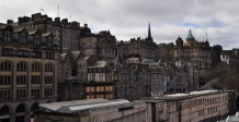 (Filtered and cropped) Edinburgh, a mishmash of buildings stacked on hills. Dense, old, and fascinating.