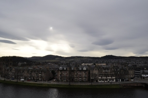 Inverness with incredible clouds overhead and Ness Bank in front of it.