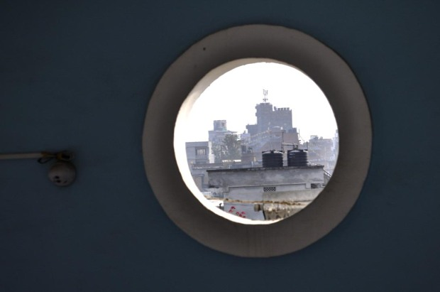 A peephole window on the landing between the fourth and fifth floors of the Kathmandu Guest House