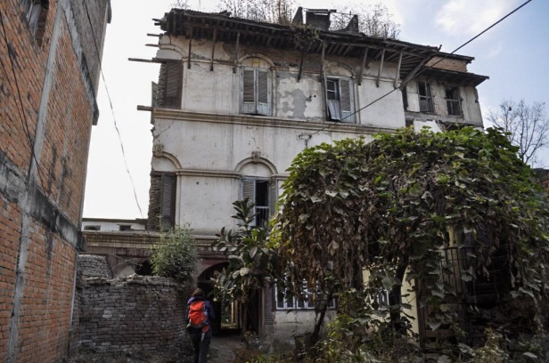Approaching a building heavily damaged by the earthquake